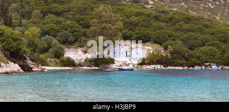 Atheras Beach, Kefalonia surrounded by a beautiful landscape of tree covered hills and sea. - Stock Photo