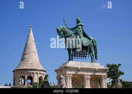 Equestrian statue of St Stephen (Szent Istvan Kiraly), with the Fishermen's Bastion behind, Budapest, Hungary - Stock Photo