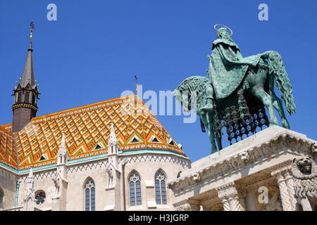 Equestrian statue of St Stephen, on Castle Hill, with the Matthias Church in the background, Budapest, Hungary - Stock Photo