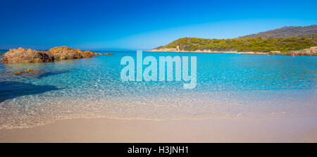 Beautiful sandy beach with rocks and tourquise clear water near Cargese, Corsica, France, Europe.