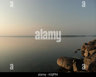 Breakwater and clear water, Lake Unden, Sweden - Stock Photo