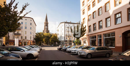 Apartments and the Zionskirche in the afternoon near Kastanienallee, Prenzlauer Berg, Berlin - Stock Photo