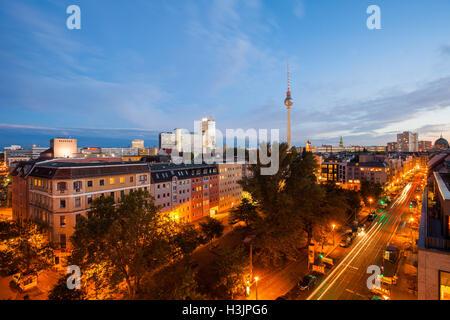 Berlin's Alexanderplatz and Fernsehturm at twilight - Stock Photo