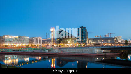 Berlin Haputbahnhof (Main Station) and River Spree at twilight - Stock Photo