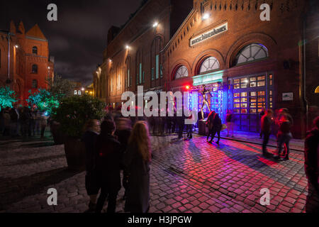 BERLIN - October 8, 2016: Clubgoers wait in line for Battle of the Bands at the Maschinenhaus in the Kulturbrauerei, - Stock Photo