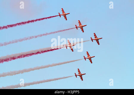 The Polish Air Force aerobatic team, the Bialo-Czerwone Iskry (White and Red Sparks), flying in formation - Stock Photo