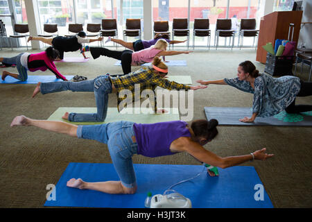 Yoga class at Haven For Hope homeless facility in San Antonio, Texas. - Stock Photo