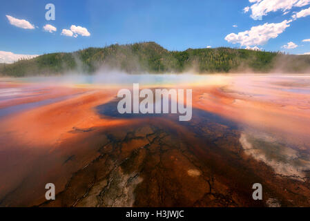 Beautiful cerulean geyser Grand Prismatic Spring in Yellowstone National Park - Stock Photo
