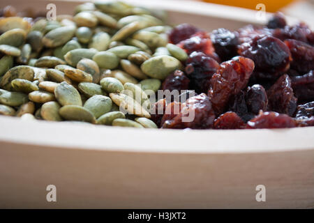 Dry fruit with pumpkin seed in the wooden bowl - Stock Photo