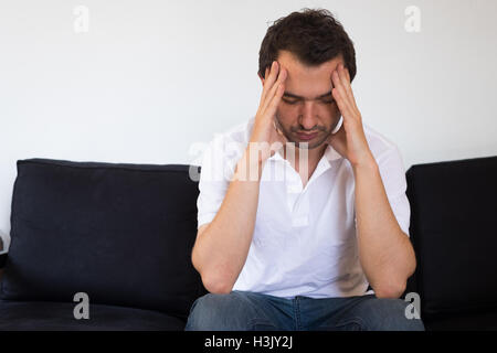 Portrait of thoughtful sad man - Stock Photo