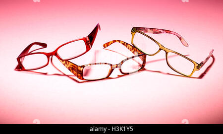 Three pairs of glasses on a pink background - Stock Photo
