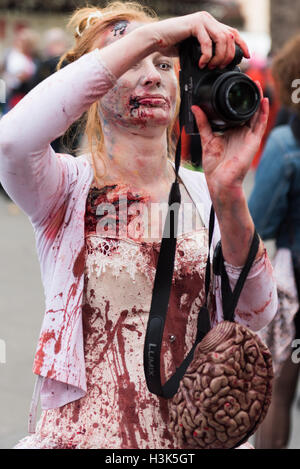 London, UK, 8 October 2016. Zombies in Central London celebrating World Zombie Day while raising funds for St Mungo's - Stock Photo