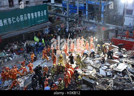 Wenzhou. 10th Oct, 2016. Rescuers work at the accident site after buildings collapsed in Wenzhou City, east China's - Stock Photo