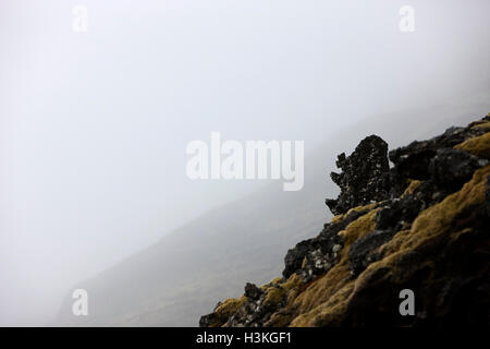 troll face in the volcanic lava field rocks Iceland - Stock Photo
