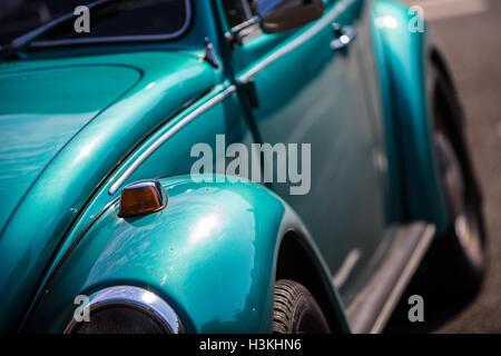 Metallic Green Volkswagen Beetle Classic Shape - Stock Photo