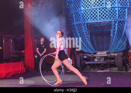 Bognor Regis, APR 10: The fun Zyair Circus show with woman playing Hula Hoop on APR 10, 2016 at Bognor Regist - Stock Photo