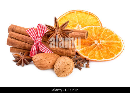 Christmas spices on white. Traditional christmas decoration with cinnamon anise and orange slices. Stock Photo