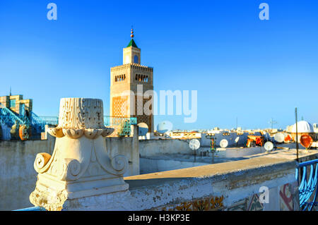 The ancient ruined column on the roof of the old house in Medina, Tunis, Tunisia. - Stock Photo