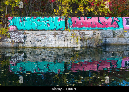 A view of graffiti in the Soulange Canal. - Stock Photo