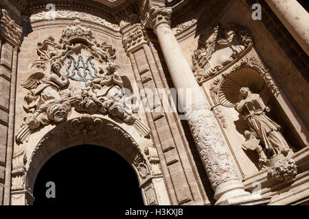 Statues and carvings above the entrance to the El Miguelete Bell Tower in Valencia - Stock Photo