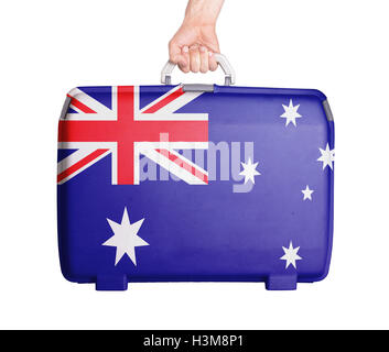 Used plastic suitcase with stains and scratches - Stock Photo