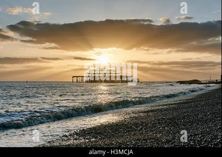 Brighton beach at sunset, England - Stock Photo