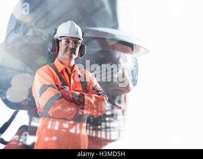 Composite image of construction worker showing full health and safety wear - Stock Photo
