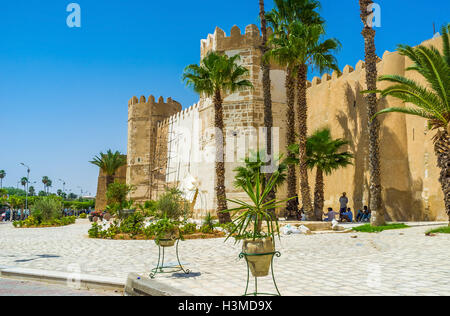 The old town walls of Sfax surrounded by tropic garden in Sfax. - Stock Photo