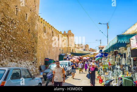 The half of all Medina walls in town surrounded by the outdoor market in Sfax - Stock Photo