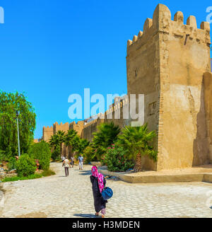 The shady park along the town walls is the best way to hide from the midday sun in Sfax. - Stock Photo