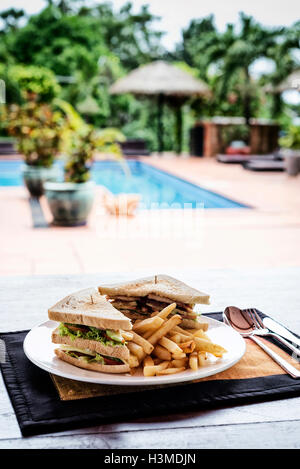 club sandwich snack with french fries on plate - Stock Photo