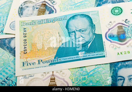 New polymer five pound notes England UK United Kingdom GB Great Britain - Stock Photo