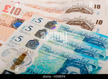 New polymer five pound notes and paper ten pound notes England UK United Kingdom GB Great Britain - Stock Photo