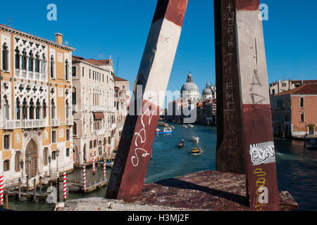 A view of the Grand canal from the wooden bridge of Accademia in Venice - Stock Photo