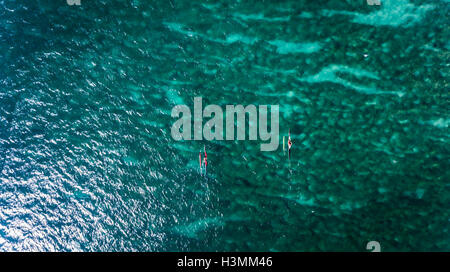 Aerial view of two Outrigger canoe's on the north shore of Oahu Hawaii - Stock Photo