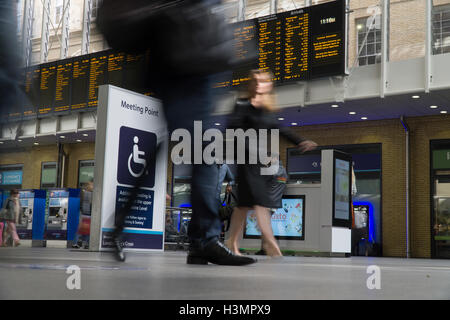 Slow shutter speed used to record exaggerated movement of People in Kings Cross St Pancreas Station,London,U.K. - Stock Photo