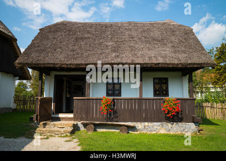 Traditional house with thatched roof  in Kumrovec, Croatia - Stock Photo