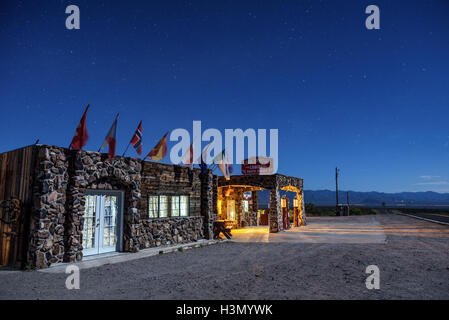 Night sky with many stars above rebuilt Cool Springs station in the Mojave desert on historic route 66 in Arizona - Stock Photo