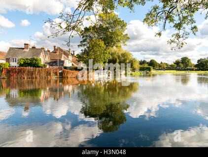 Looking across the River Avon from The George pub at Fordingbridge, Hampshire, UK, on a bright October afternoon. - Stock Photo
