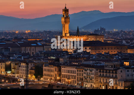The Palazzo Vecchio and the city of Florence at night - viewed from Piazzale Michelangelo. - Stock Photo