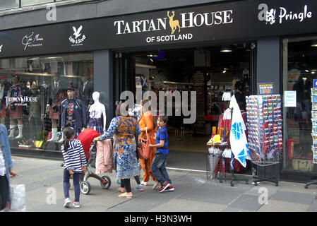 Asian refugees dressed  on street in the UK everyday scene Hijab scarf - Stock Photo
