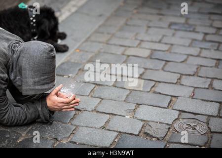 Begger on the street - Stock Photo