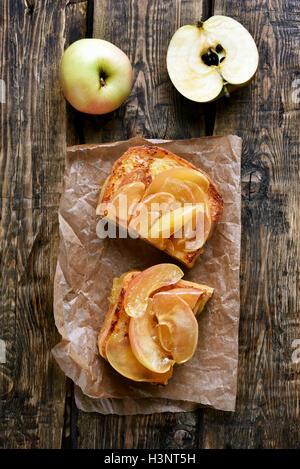 Caramelized apples on toast bread, top view