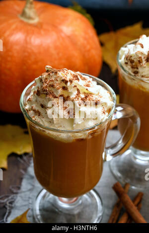 Pumpkin smoothie, latte with whipped cream and cinnamon - Stock Photo