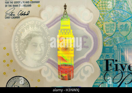 New (2016) British plastic £5 note showing security features: transparent 'watermark'; Big Ben hologram; 'Eurion - Stock Photo