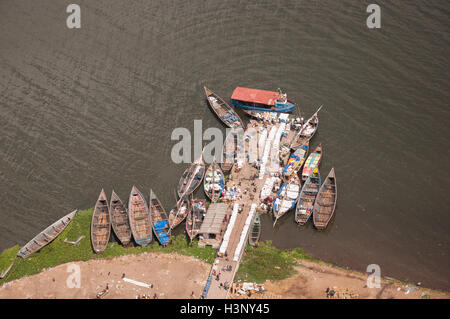 Local trade and fishing boats moored by a jetty on the southern shore of Lake Victoria, Mwanza Tanzania. - Stock Photo