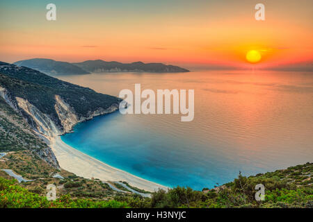 The sunset at the famous beach Myrtos in Kefalonia island, Greece - Stock Photo