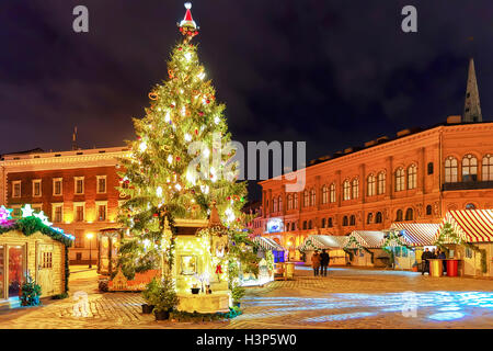 Lonely streets in the old town during the Christmas celebrations in old Riga, Latvia. At the fair people can buy - Stock Photo