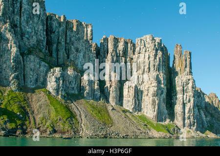 Cliffs at Alkefjellet, Svalbard, Norway - Stock Photo