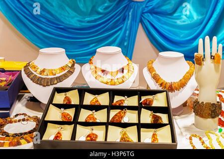 Amber bijouterie at Vilnius Christmas market in Lithuania. - Stock Photo